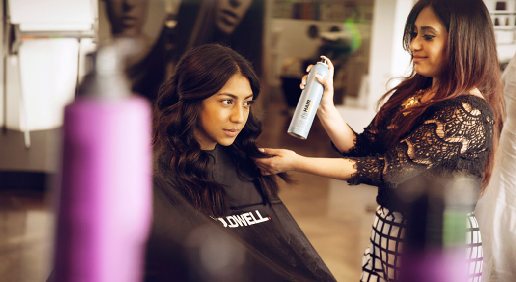 Hair stylist and customer in Goldwell® salon